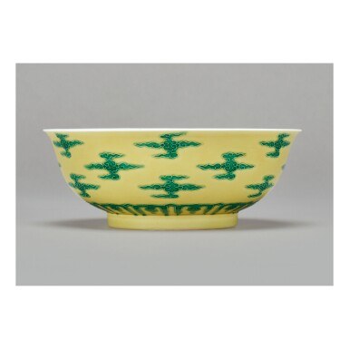 View 1. Thumbnail of Lot 106.  A RARE YELLOW-GROUND GREEN-ENAMELED 'CLOUD SCROLL' BOWL , KANGXI MARK AND PERIOD.