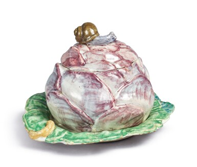 View 1. Thumbnail of Lot 152. A CONTINENTAL FAIENCE RED-CABBAGE TUREEN AND COVER ON FIXED STAND, LATE 18TH CENTURY.
