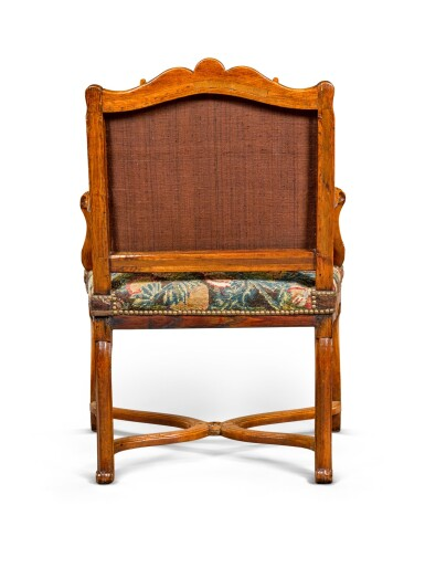 View 4. Thumbnail of Lot 52. A Régence provincial carved beechwood fauteuil, circa 1730.