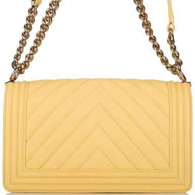 View 6. Thumbnail of Lot 98. CHANEL |  YELLOW CHEVRON OLD MEDIUM BOY BAG OF CAVIAR LEATHER WITH LIGHT GOLD TONE HARDWARE.