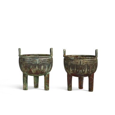 View 1. Thumbnail of Lot 1. An extremely rare pair of archaic bronze ritual food vessels (Ding), Late Shang dynasty   商末 子龔鼎一對.