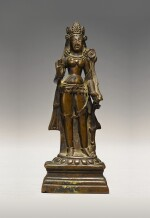 A COPPER ALLOY FIGURE OF TARA WITH SILVER INLAY,  KASHMIR, 9TH/10TH CENTURY