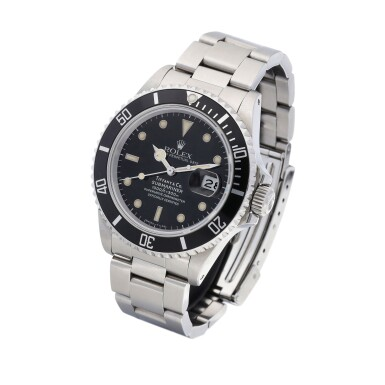 View 2. Thumbnail of Lot 8015. Rolex | Submariner, Reference 168000, A stainless steel wristwatch with date and bracelet, Retailed by Tiffany & Co., Circa 1988 | 勞力士 | Submariner 型號168000   精鋼鏈帶腕錶,備日期顯示,由Tiffany & Co.發行,約1988年製.