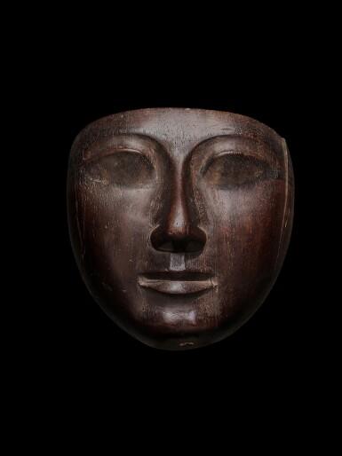 View 1. Thumbnail of Lot 58. An Egyptian Wood Mummy Mask, 22nd/24th Dynasty, 944-716 B.C..