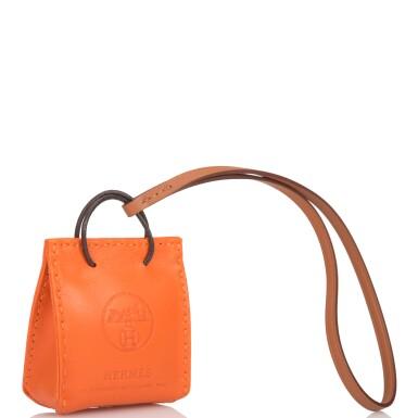 View 2. Thumbnail of Lot 100. Hermès Orange Bag Charm.
