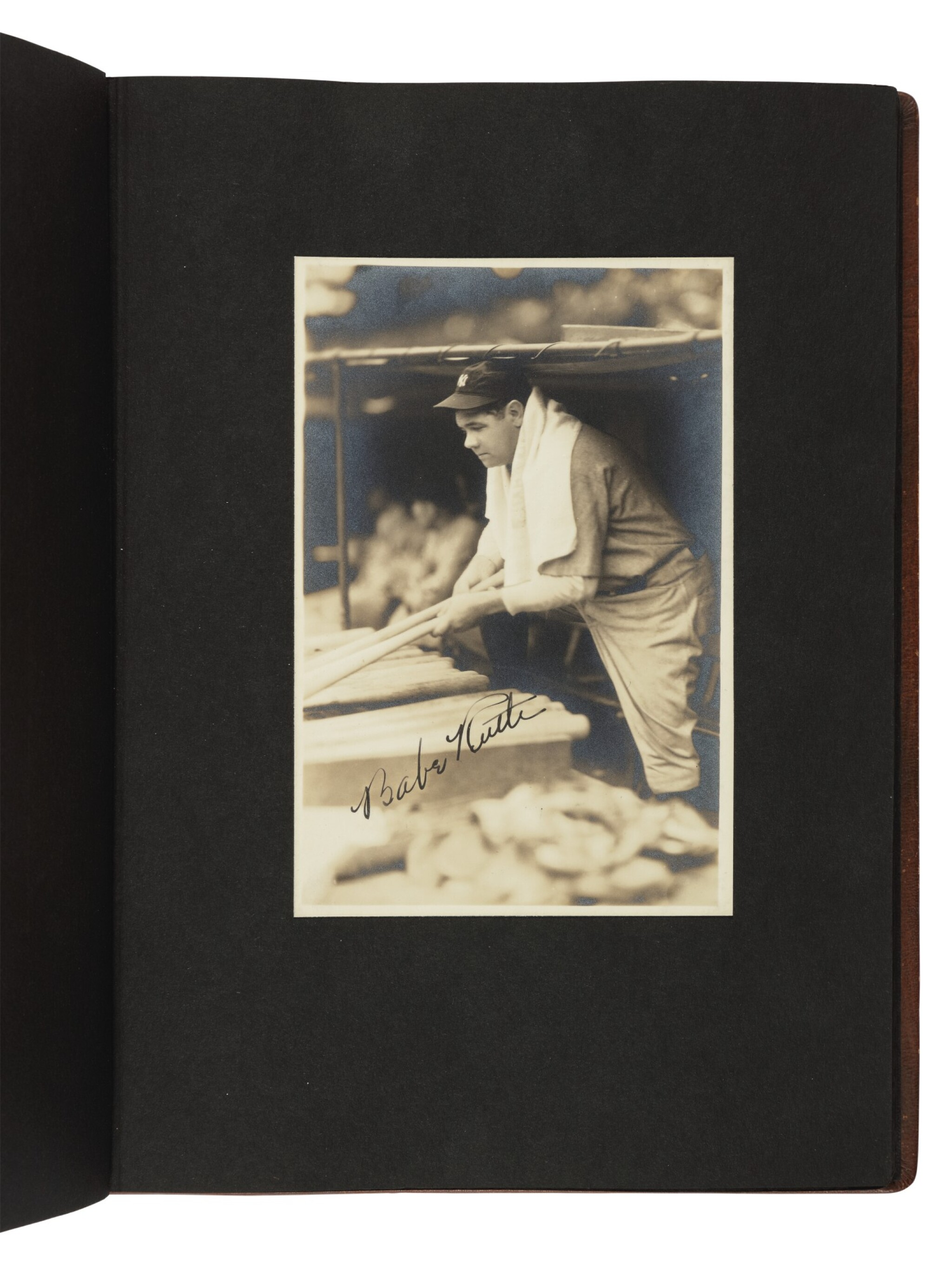 View full screen - View 1 of Lot 145. The New York Yankees | Photo album of the 1931 New York Yankees, signed by 19 members of the team, including 10 future Hall of Famers, made for Yankees coach Jimmy Burke.