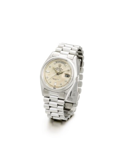 """View 2. Thumbnail of Lot 2133. ROLEX   DAY-DATE, REFERENCE 6611B, A WHITE GOLD AND DIAMOND-SET WRISTWATCH WITH DAY, DATE AND BRACELET, CIRCA 1958   勞力士   """"Day-Date 型號6611B 白金鑲鑽石鏈帶腕錶,備日期及星期顯示,錶殼編號401552,約1958年製""""."""