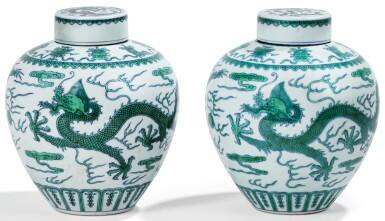 View 1. Thumbnail of Lot 13. DEUX JARRES COUVERTES EN PORCELAINE BLEU BLANC ÉMAILLÉE VERT MARQUES ET ÉPOQUE QIANLONG   清乾隆 青花綠釉龍紋蓋罐兩件 《大清乾隆年製》款   Two green-enamelled 'dragon' jars and covers, Qianlong seal marks and period .