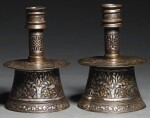 TWO MINIATURE MAMLUK SILVER AND GOLD-INLAID BRASS CANDLESTICKS, EGYPT OR SYRIA, EARLY 15TH CENTURY