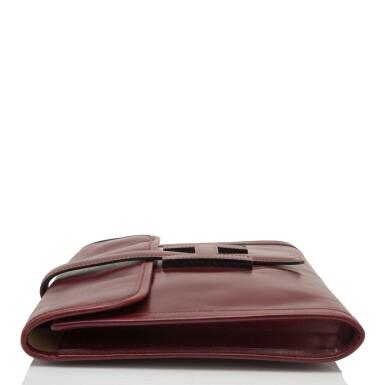 View 3. Thumbnail of Lot 24. Hermès Vintage Rouge H Box Jige Elan Clutch 29cm.