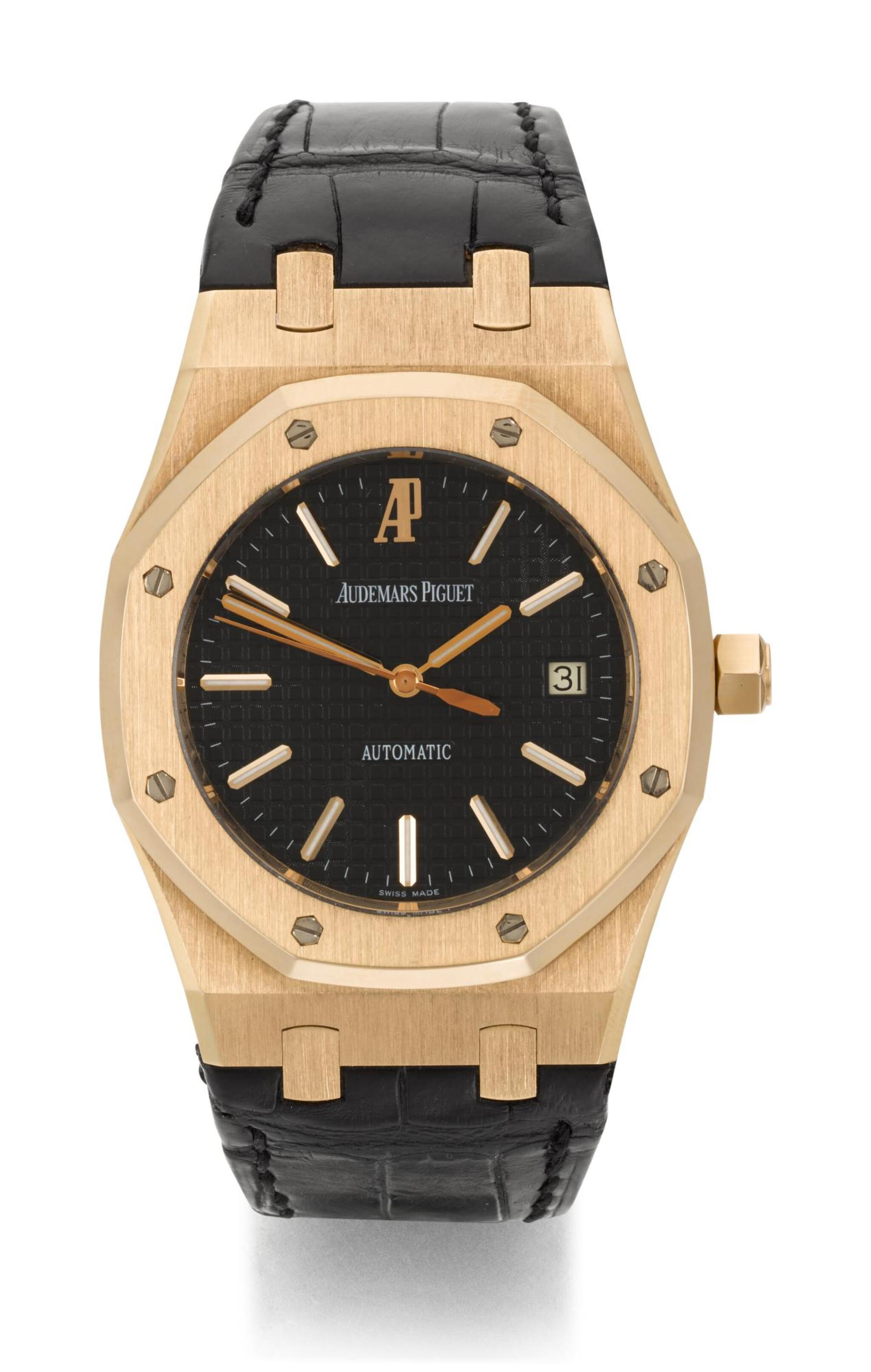 View full screen - View 1 of Lot 31. AUDEMARS PIGUET   ROYAL OAK, REFERENCE 15300OR.OO.D002CR.01,  PINK GOLD WRISTWATCH WITH DATE,  CIRCA 2006.