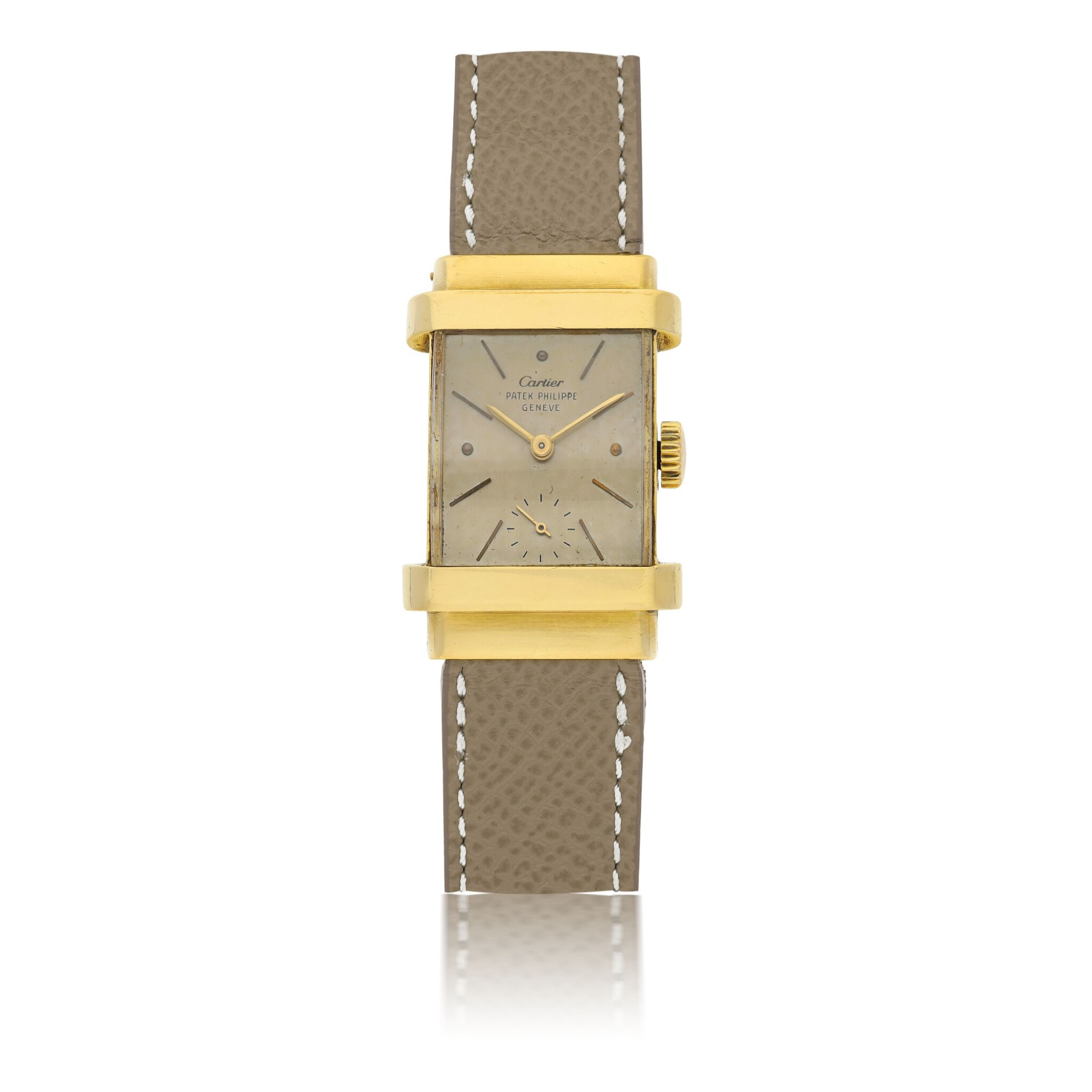 View full screen - View 1 of Lot 112. PATEK PHILIPPE | REF 1450 'TOP HAT', RETAILED BY CARTIER: A YELLOW GOLD RECTANGULAR WRISTWATCH CIRCA 1950.