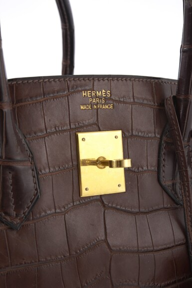 View 6. Thumbnail of Lot 20. Matte havanne niloticus crocodile, canvas and gold plated hardware handbag, Birkin 35, Hermès, 2002.