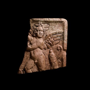 View 1. Thumbnail of Lot 81. A Roman Red Marble Double-sided Relief with Erotes, late 2nd/3rd Century A.D..