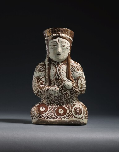 A KASHAN LUSTRE POTTERY VESSEL IN THE FORM OF A SEATED FEMALE RULER, PERSIA, 12TH/13TH CENTURY