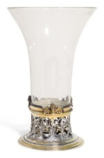 AN ITALIAN GLASS BEAKER WITH CONTINENTAL PARCEL-GILT SILVER FOOT MOUNT, UNMARKED, CIRCA 1630