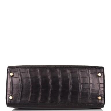 View 6. Thumbnail of Lot 44. Hermès Black Retourne Kelly 28cm of Matte Alligator with Gold Hardware.