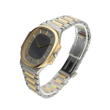 View 3. Thumbnail of Lot 134. PATEK PHILIPPE      REFERENCE 3770 'NAUTELLIPSE' A YELLOW GOLD AND STAINLESS STEEL OVAL FORM BRACELET WATCH, CIRCA 1982.
