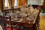 An early 19th C Mahogany Dining Table by Gillow & Co. with a set of 12 carved Dining Chairs in the Chippendale Style, and a Thomas Goode 'Stewart' bone china part dinner and dessert service, and an original antique glass from the Thomas Goode archive, various dates