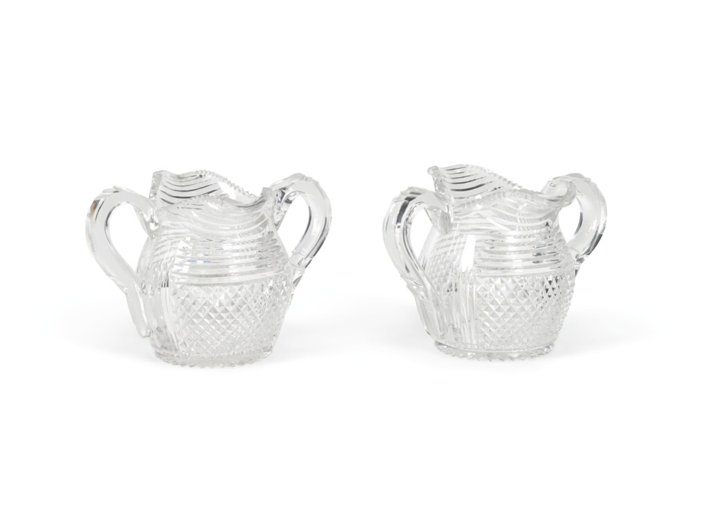 A SET OF ELEVEN CUT-GLASS DOUBLE-HANDLED CREAM JUGS, CIRCA 1820