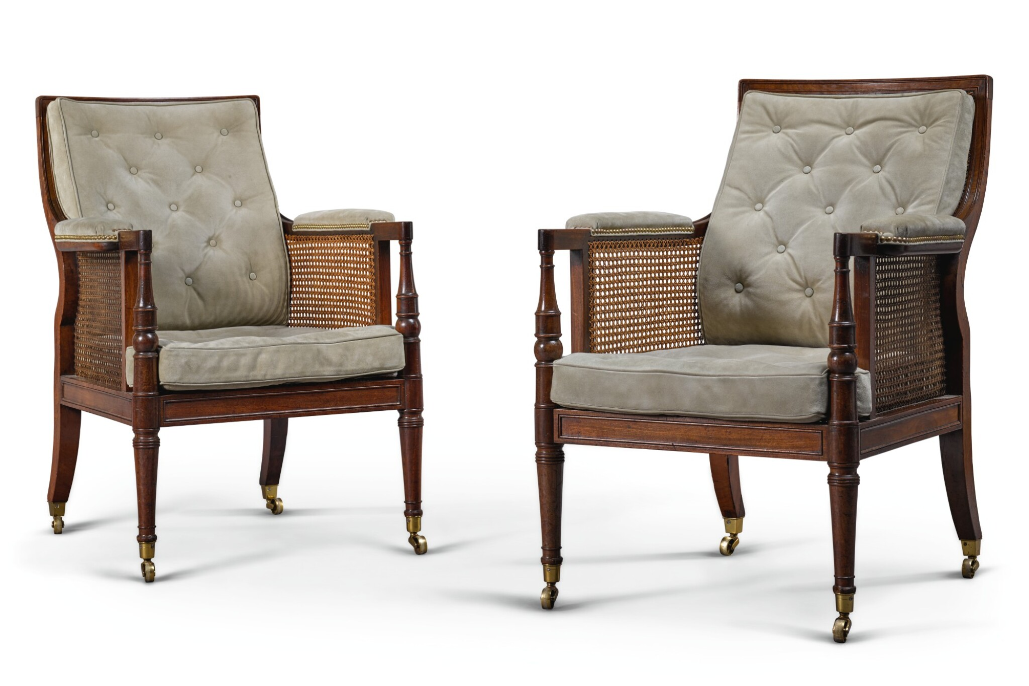 View full screen - View 1 of Lot 16. A PAIR OF REGENCY CANED MAHOGANY LIBRARY ARMCHAIRS, FIRST QUARTER 19TH CENTURY, ATTRIBUTED TO GILLOWS.