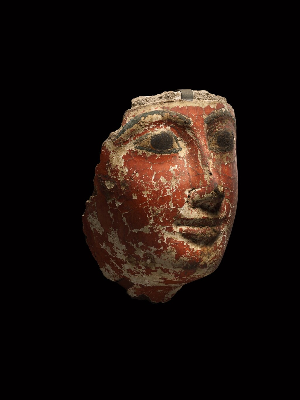 AN EGYPTIAN POLYCHROME CARTONNAGE MUMMY MASK, 19TH/21ST DYNASTY, 1292-944 B.C.
