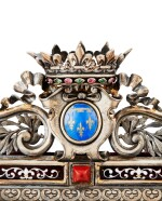 A PART-GILT, ENAMEL, COLOURED GLASSES, EMERALD AND GARNETS FRAME WITH THE ARMS OF FRANCE, BY EMILE FROMENT-MEURICE, CIRCA 1883 | CADRE AUX ARMES DE FRANCE EN ARGENT PARTIELLEMENT DORÉ, ÉMAILLÉ, SERTI DE VERRES DE COULEUR, ÉMERAUDES ET GRENATS PAR EMILE FROMENT-MEURICE, VERS 1883