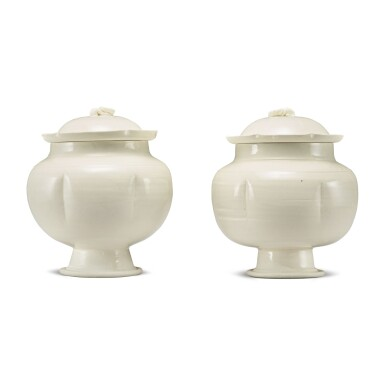 View 1. Thumbnail of Lot 184. A pair of white-glazed footed jars and covers, Northern Song / Jin dynasty | 北宋 / 金 白釉瓜棱式高足蓋罐一對.