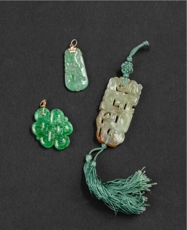 View 2. Thumbnail of Lot 65. Ensemble de trois pendentifs sculptés en jade et en jadéite XIXE-XXE siècle   十九至二十世紀 玉珮 一組三件   A group of three céladon jade and jadeite pendants, 19th-20th century.