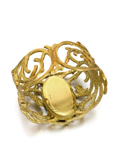 View 3. Thumbnail of Lot 48. BUECHE GIROD | AN UNUSUAL YELLOW GOLD CUFF WATCH WITH TIGER'S EYE DIAL CIRCA 1975.