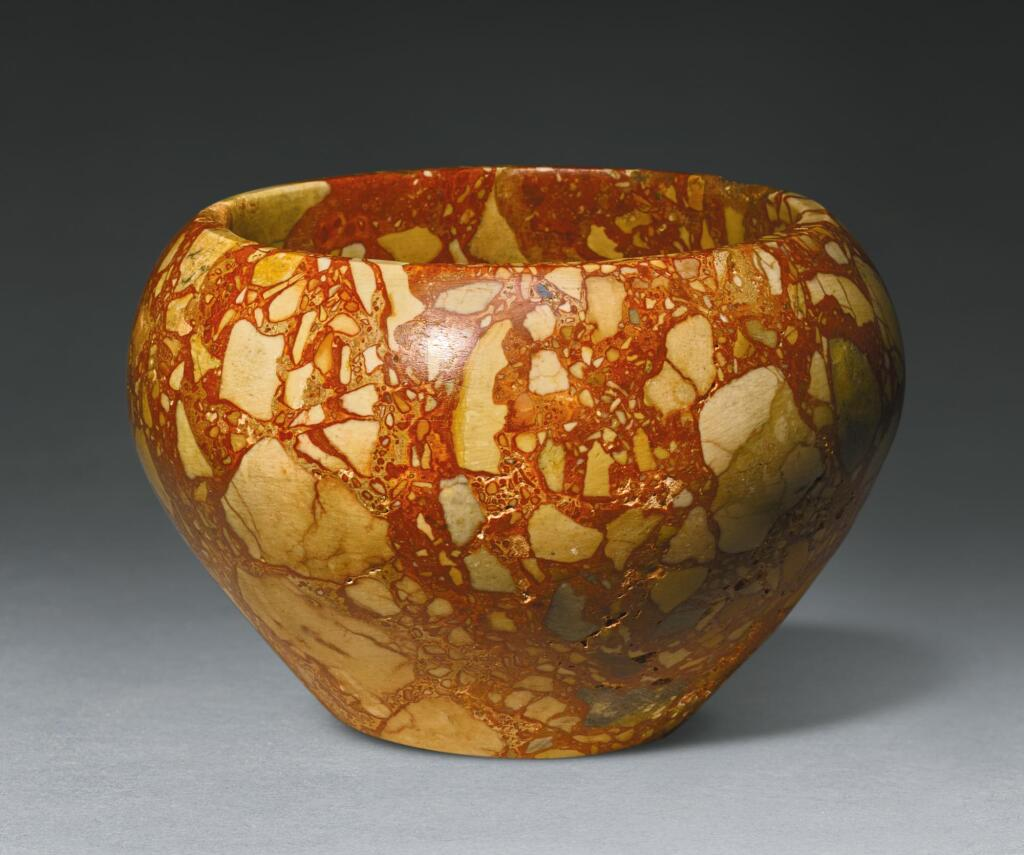 A LARGE EGYPTIAN BRECCIA BOWL, 1ST/2ND DYNASTY, 2965-2750 B.C.