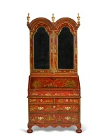 A George I gilt heightened red japanned bureau cabinet, first quarter 18th century