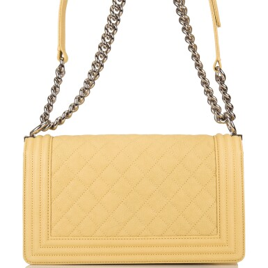 View 4. Thumbnail of Lot 84. Chanel Yellow Quilted Old Medium Boy Bag of Caviar Leather with Silver Hardware.