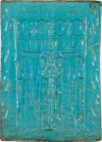 A LARGE TURQUOISE-GLAZED MIHRAB-SHAPED POTTERY TILE, PERSIA, 12TH/13TH CENTURY