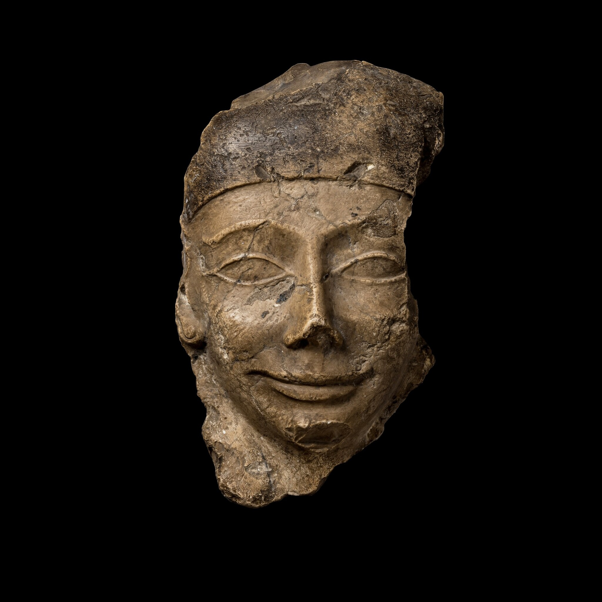 View 1 of Lot 43. A Fragmentary Egyptian Polychrome Limestone Sarcophagus Mask, 30th Dynasty/early Ptolemaic Period, circa 380-250 B.C..