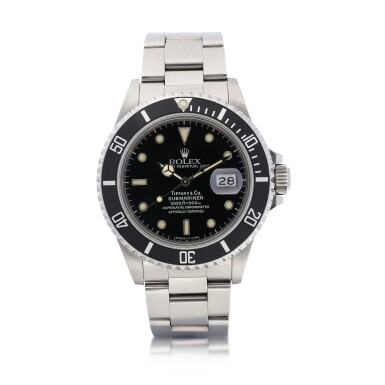 View 1. Thumbnail of Lot 8015. Rolex | Submariner, Reference 168000, A stainless steel wristwatch with date and bracelet, Retailed by Tiffany & Co., Circa 1988 | 勞力士 | Submariner 型號168000   精鋼鏈帶腕錶,備日期顯示,由Tiffany & Co.發行,約1988年製.