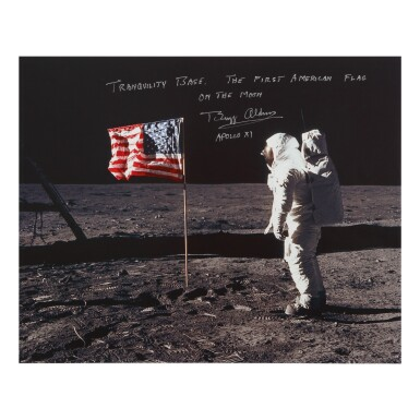 [APOLLO 11]. ALDRIN WITH THE STARS AND STRIPES. COLOR PHOTOGRAPH, SIGNED AND INSCRIBED BY BUZZ ALDRIN