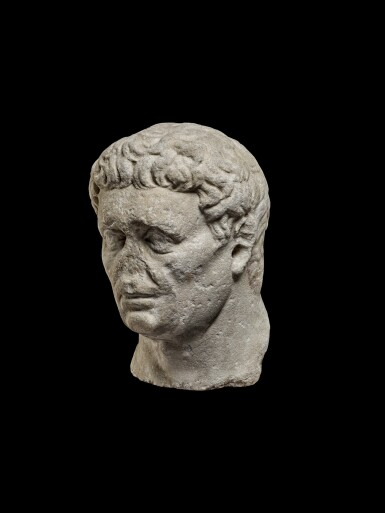 View 2. Thumbnail of Lot 75. A Monumental Marble Portrait Head of the Emperor Nerva, late 1st Century A.D..