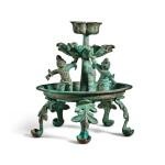 A bronze oil lamp, Tang dynasty | 唐 銅天王花式五足燈