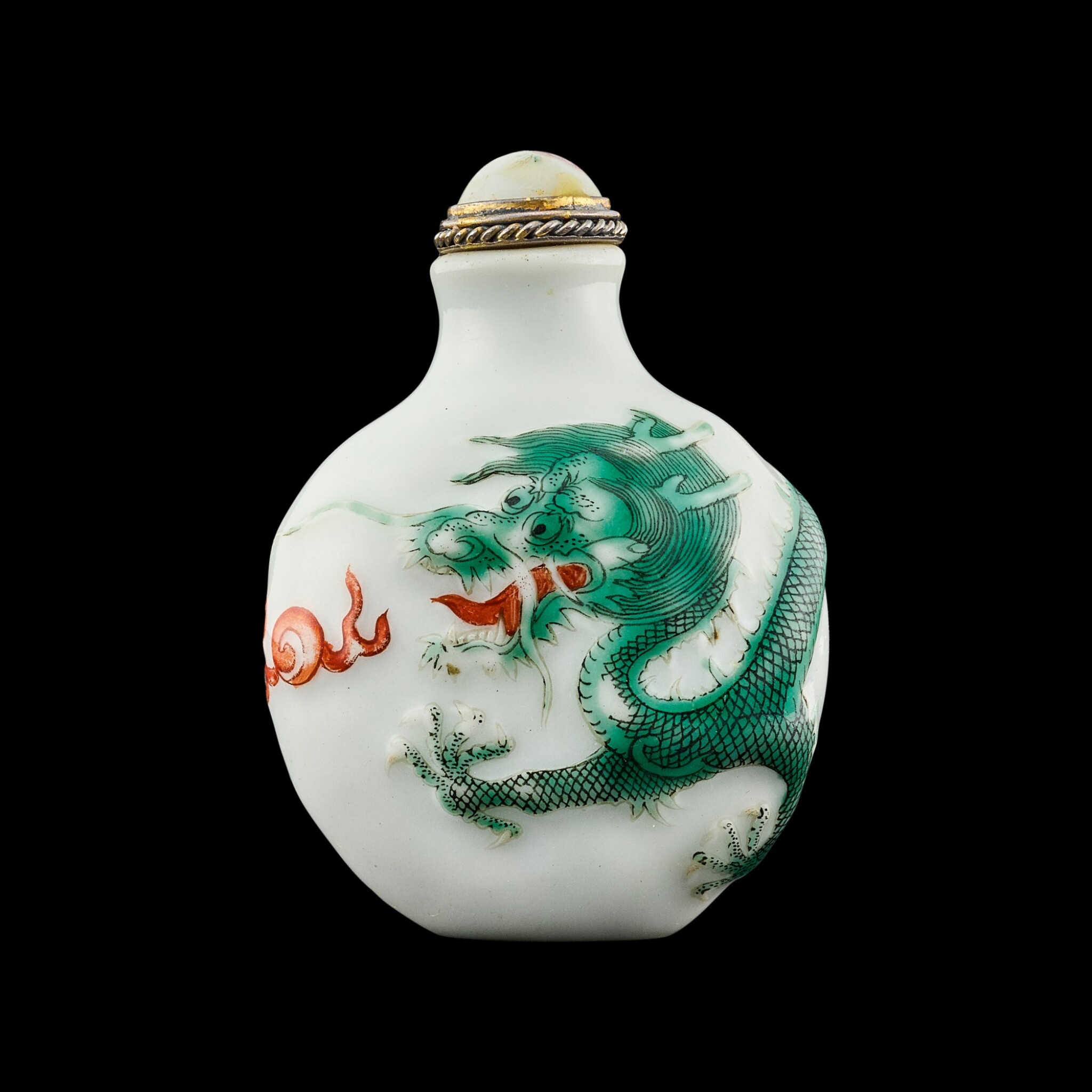 View full screen - View 1 of Lot 1035. A moulded and enamelled porcelain 'dragon' snuff bottle Seal mark and period of Daoguang   清道光 瓷胎模印紅綠彩游龍趕珠紋鼻煙壺 《道光年製》款.
