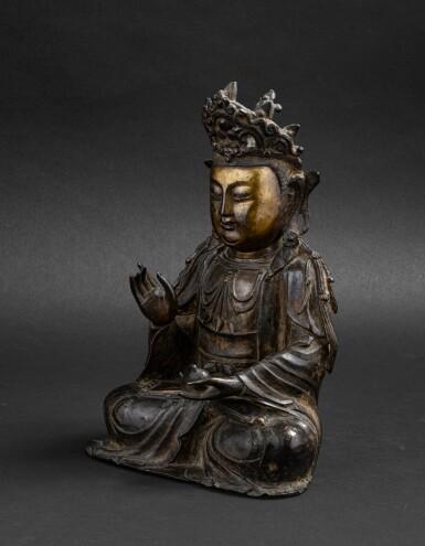 View 2. Thumbnail of Lot 37. Figure de Guanyin en bronze partiellement doré Dynastie Ming, XVIE-XVIIE siècle | 明十六至十七世紀 局部鎏金銅觀音菩薩坐像 | A parcel-gilt bronze figure of Guanyin, Ming Dynasty, 16th-17th century.