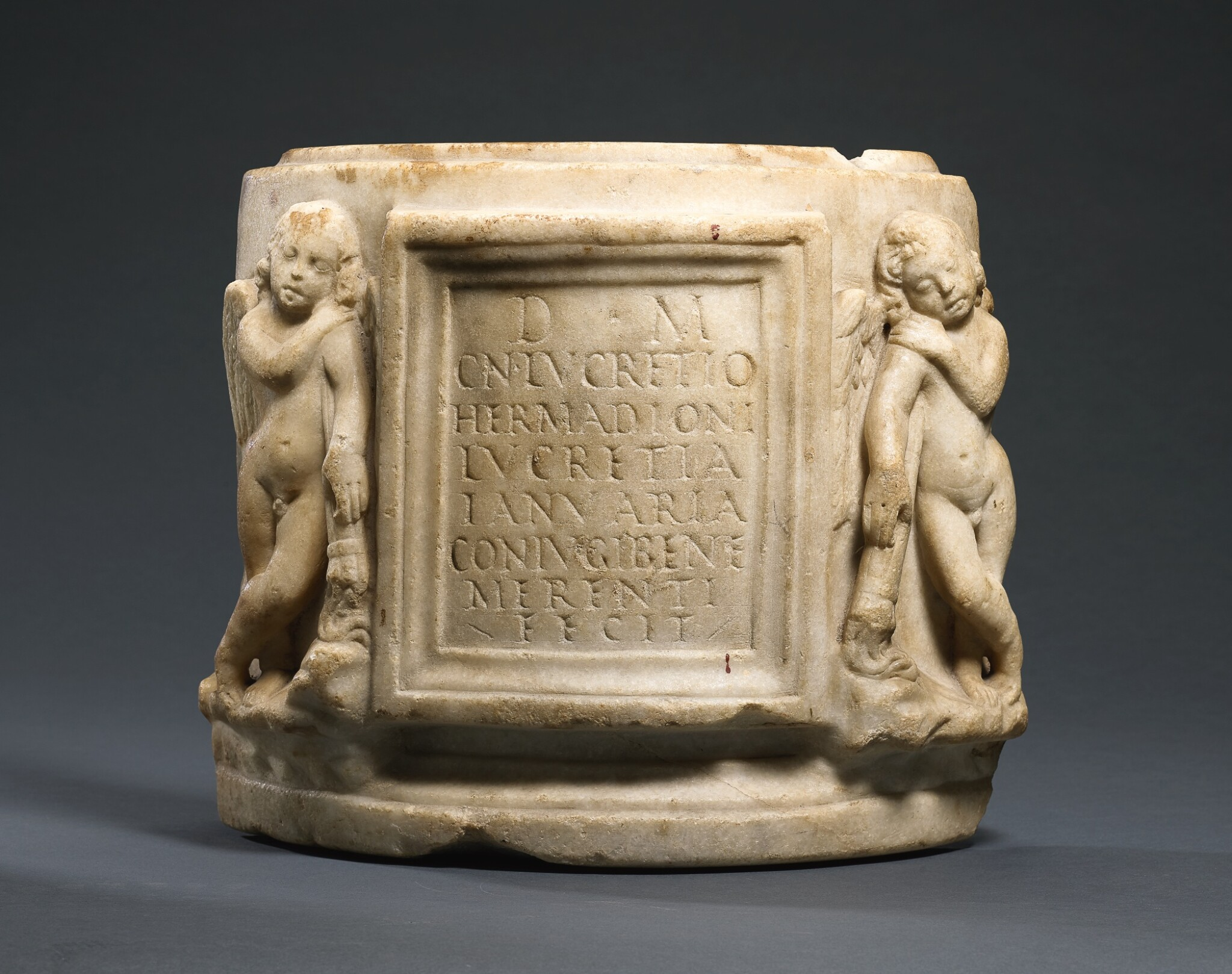 View full screen - View 1 of Lot 50. A FRAGMENTARY ROMAN MARBLE CINERARY URN, 1ST/2ND CENTURY A.D..