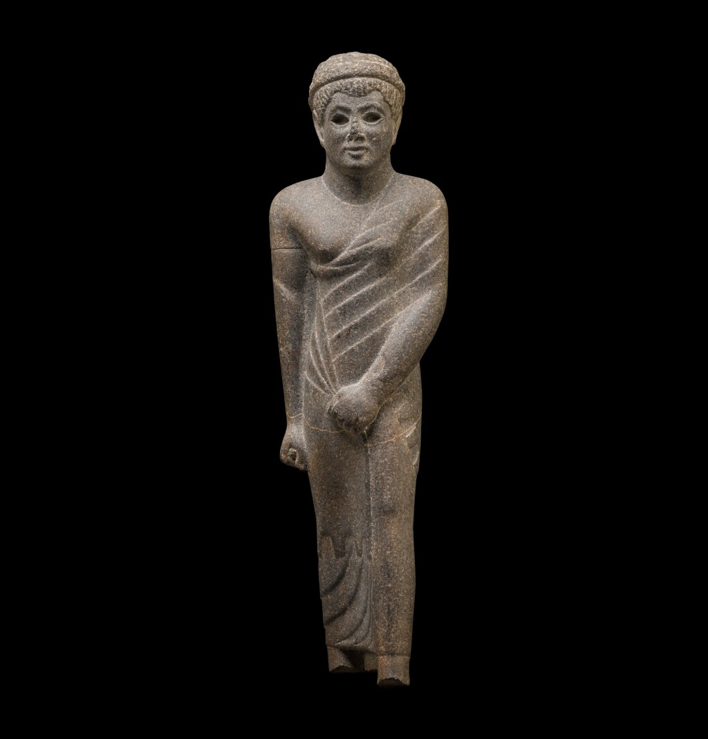 AN EGYPTIAN GRANITE FIGURE OF PAKHOM, GOVERNOR OF DENDERA, LATE PTOLEMAIC PERIOD, CIRCA 50-30 B.C.