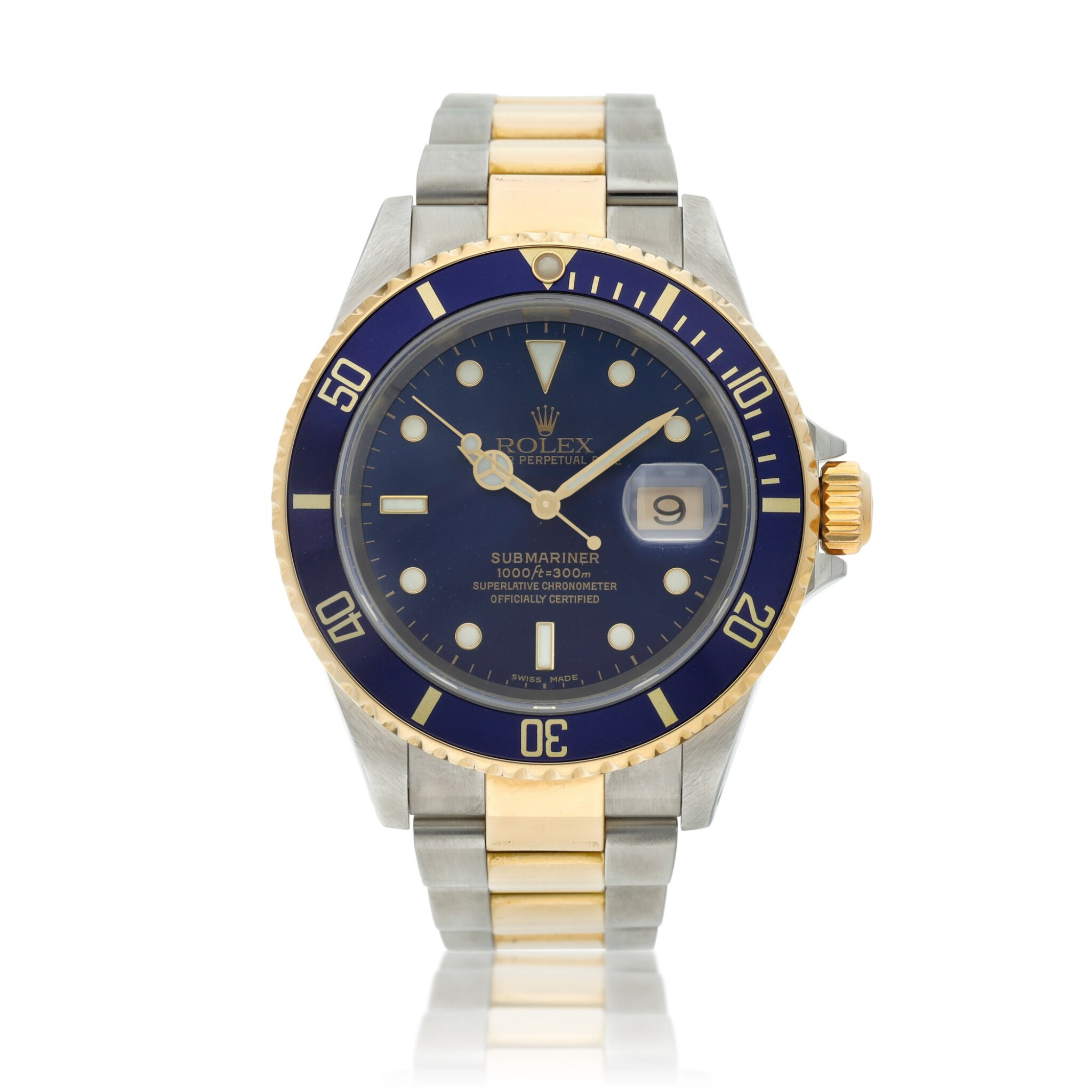View full screen - View 1 of Lot 10. Reference 16613 Submariner  A yellow gold and stainless steel wristwatch with date and bracelet, Circa 2002 .