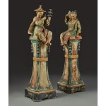 A PAIR OF POLYCHROME-DECORATED SEATED CHINOISERIE FIGURES