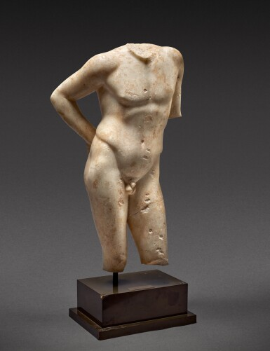 View 2. Thumbnail of Lot 27. A Roman Marble Torso of Narcissus, circa 1st Century A.D..