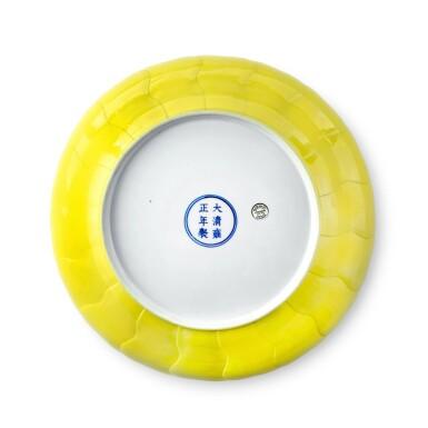 View 2. Thumbnail of Lot 73. A rare molded lemon-yellow-enameled 'lotus' dish, Mark and period of Yongzheng   清雍正 檸檬黃釉蓮花式盤 《大清雍正年製》款.