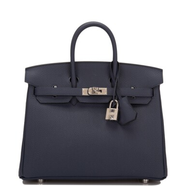 View 1. Thumbnail of Lot 4. Hermès Bleu Nuit Birkin 25cm of Togo Leather with Palladium Hardware.