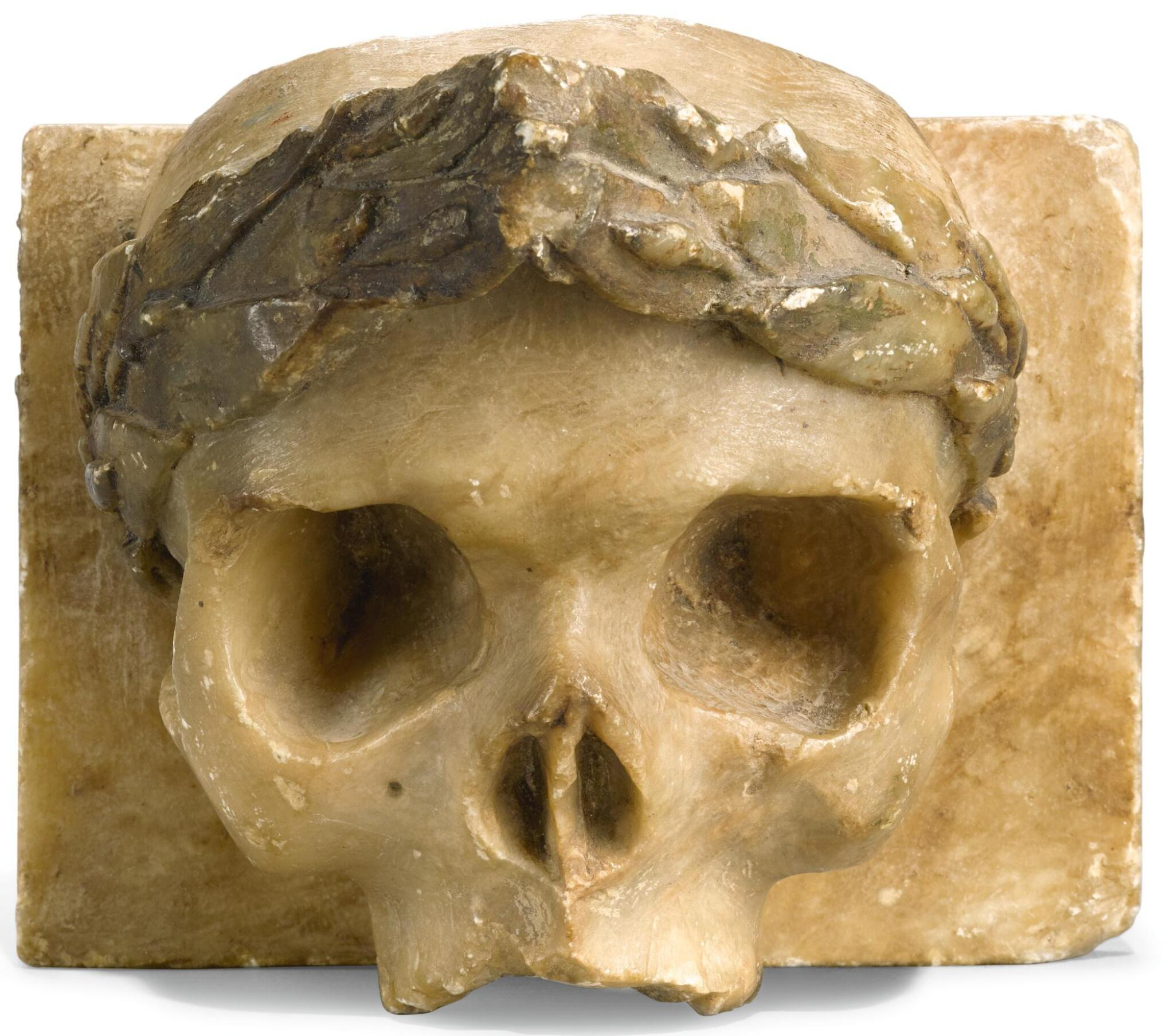View full screen - View 1 of Lot 85. ENGLISH, 18TH CENTURY | HIGH RELIEF OF A SKULL.