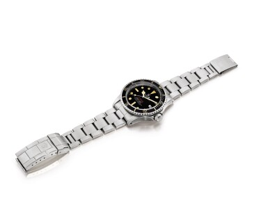 """View 4. Thumbnail of Lot 2141. Rolex   """"Double Red"""" Sea-Dweller, Reference 1665, A stainless steel wristwatch with date and bracelet, Circa 1977   勞力士   """"Double Red"""" Sea-Dweller型號1665  精鋼鏈帶腕錶,備日期顯示,約1977年製."""